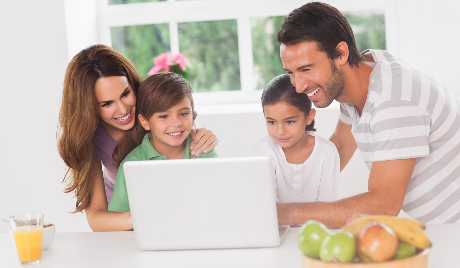 family-at-home-reading-laptop-information-london-city-mortgages